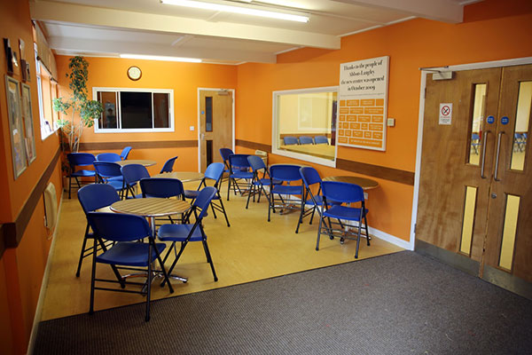 Photo of coffee area with orange paint
